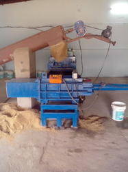SAW DUST BALING MACHINE