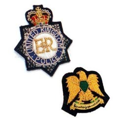 police service cap badges