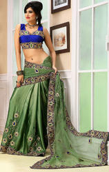 Rusty+Pista+Green+Net+and+Satin+Chiffon+Sarees+with+Blouse