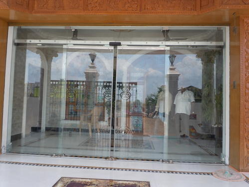 Automatic sliding glass doors doors and windows indian for Sliding door main entrance