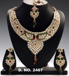 designer red green polki necklace set