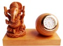 wooden ganesha with clock