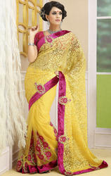 Yellow+Color+Brasso+and+Net+Sarees+with+Saree