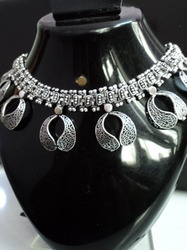 white metallic necklace