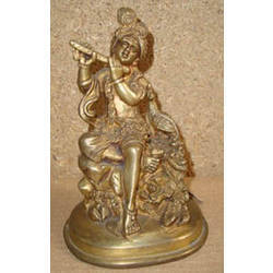 Krishna Sitting w/ Peacock on Rock