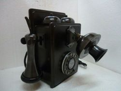 antique wall mount telephone with original shrill ringtone