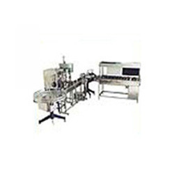 Automatic Bottle Filling & Cap Sealing Machine - Pharma Chem