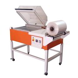 Mild Steel Orange And Grey Shrink Wrapping Machine, 3.5Kw