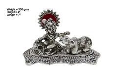 Silver Plated White Metal Bal Krishna Sitting With Cow