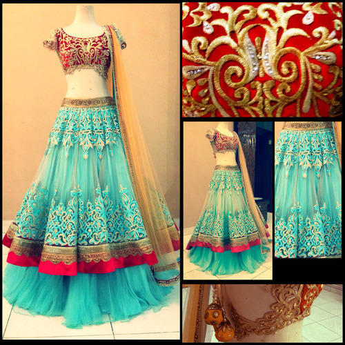 Color Designer bollywood lehengas - red and gold bridal lehenga manufacturer from