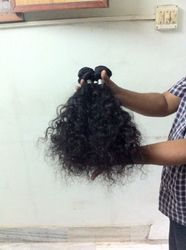 UNPROCESSED HUMAN HAIR EXTENSIONS