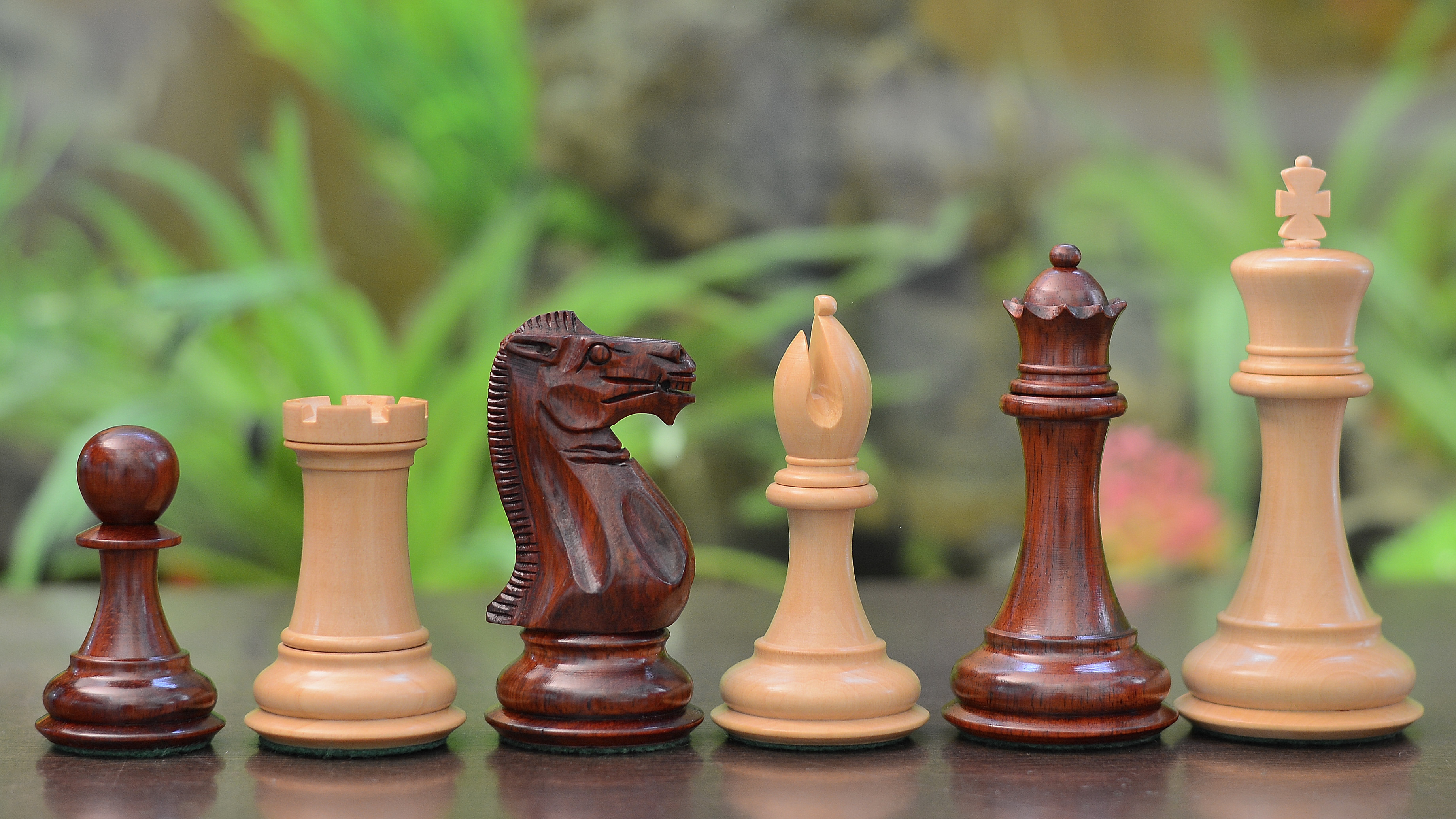 the staunton series triple weighted chess pieces in red bud