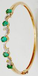 Yellow Gold Emerald Bangle Bracelet