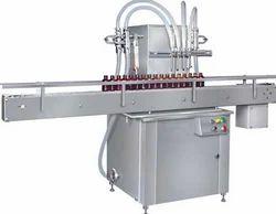 Bottle Filling Machine, 230 V, Single Phase, Capacity: 20-30 Bottles/ Min