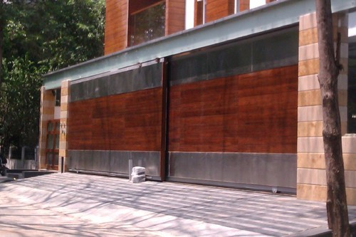 Wooden sliding gates sliding gates arumbakkam chennai indian entrance automation id for Wooden main gate design for home