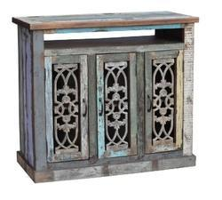 Cabinet Of Reclaimed Wood And Cast Iron Grills