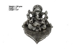 White Metal Silver Plated Ganesha Sitting On Leaf