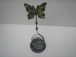 Votive with butterfly